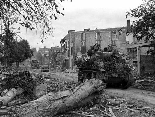 An M5A1 light tank and other vehicles of the 4th Armored Division